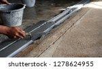 worker hand plastering cement... | Shutterstock . vector #1278624955