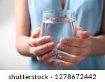 woman holding glass with fresh...   Shutterstock . vector #1278672442