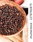 raw coffee beans in basket | Shutterstock . vector #1278782875