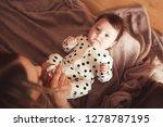 baby girl lying on mother hands ... | Shutterstock . vector #1278787195