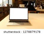 laptop mockup on white desk... | Shutterstock . vector #1278879178