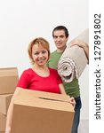 Couple moving into a new home - carrying stuff, closeup - stock photo
