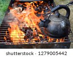 kettle for boiling water on a... | Shutterstock . vector #1279005442
