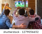 male friends watching football... | Shutterstock . vector #1279056652