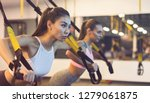 women training triceps with trx ... | Shutterstock . vector #1279061875