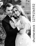 the bride and groom embarcing... | Shutterstock . vector #1279156552