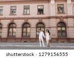 happy wedding couple in stylish ... | Shutterstock . vector #1279156555
