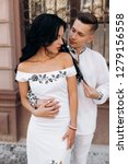 groom holds bride tender in his ... | Shutterstock . vector #1279156558