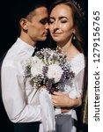 groom holds bride tender... | Shutterstock . vector #1279156765