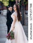 the bride and groom walking... | Shutterstock . vector #1279157788