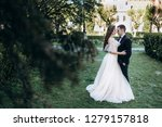 the bride and groom embracing... | Shutterstock . vector #1279157818