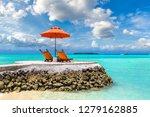 wooden sunbed and umbrella on... | Shutterstock . vector #1279162885