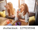 young women sit at table and... | Shutterstock . vector #1279235548