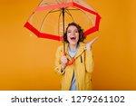 attractive woman in yellow... | Shutterstock . vector #1279261102