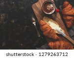 fresh croissants with butter... | Shutterstock . vector #1279263712