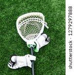 a white lacrosse goalie stick... | Shutterstock . vector #1279297888