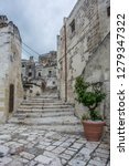 matera is an atmospheric cave... | Shutterstock . vector #1279347322
