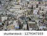matera is an atmospheric cave... | Shutterstock . vector #1279347355