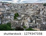 matera is an atmospheric cave... | Shutterstock . vector #1279347358