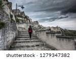 matera is an atmospheric cave... | Shutterstock . vector #1279347382