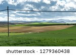 Small photo of farm landscape and cloudy sky one spring morning