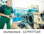 repairman polishes engine... | Shutterstock . vector #1279477165