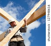 builder at work with timber ... | Shutterstock . vector #127948616