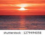 sunrise over the ocean.... | Shutterstock . vector #1279494058