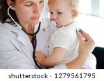 baby visiting the doctor for a... | Shutterstock . vector #1279561795