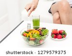 woman eating  healthy fresh... | Shutterstock . vector #1279579375
