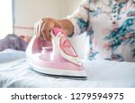 close up of woman ironing...   Shutterstock . vector #1279594975