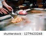 chef cook beef steak for the... | Shutterstock . vector #1279623268