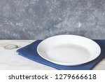 empty plate on tablecloth on... | Shutterstock . vector #1279666618