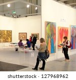 milan   april 08  women look at ... | Shutterstock . vector #127968962