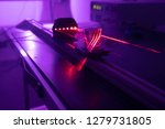 experiment with red laser in...   Shutterstock . vector #1279731805