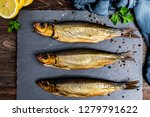 Stock photo delicious smoked salmon herring beautifully garnished on a rustic wooden table 1279791622