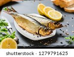 Stock photo delicious smoked salmon herring beautifully garnished on a rustic wooden table 1279791625