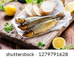 Stock photo delicious smoked salmon herring beautifully garnished on a rustic wooden table 1279791628
