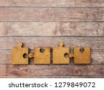 4 four brown pieces of puzzle... | Shutterstock . vector #1279849072