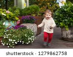 little smiling boy runs on a... | Shutterstock . vector #1279862758