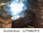 smoke comes from the brazier ... | Shutterstock . vector #1279882972