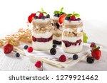 tasty yoghurts with muesli ... | Shutterstock . vector #1279921462