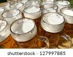 beer jugs on wooden desk ... | Shutterstock . vector #127997885