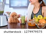 young woman drinking smoothie... | Shutterstock . vector #1279979575