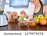 young woman drinking smoothie... | Shutterstock . vector #1279979578