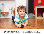a boy playing with radio... | Shutterstock . vector #1280002162