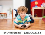 a boy playing with radio... | Shutterstock . vector #1280002165