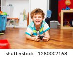 a boy playing with radio... | Shutterstock . vector #1280002168