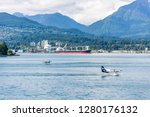 Vancouver,  British Columbia / Canada - 06/13/2015. Sea Planes and boats sharing the water in Vancouver Harbour - stock photo
