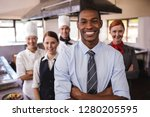 group of hotel staffs standing... | Shutterstock . vector #1280205595